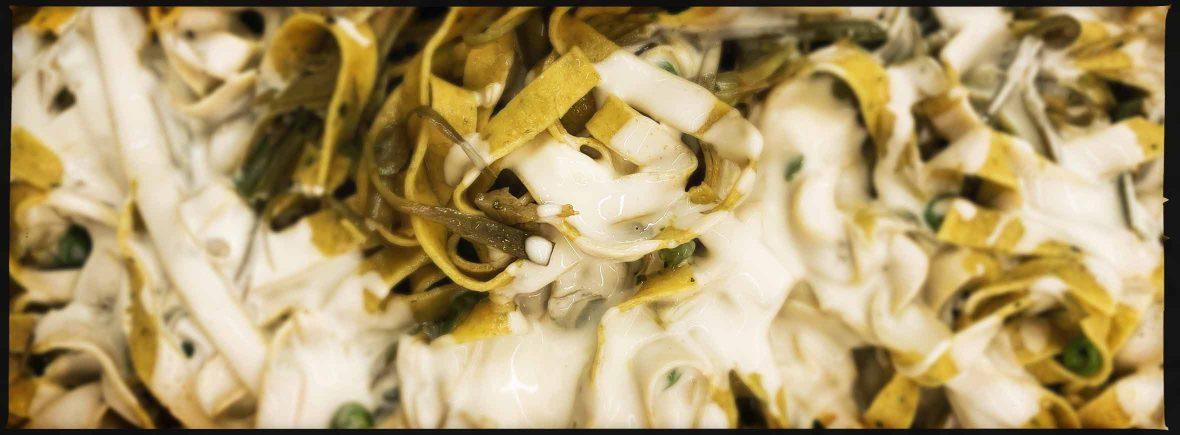 tagliatelle carciofi piselli parmigiano